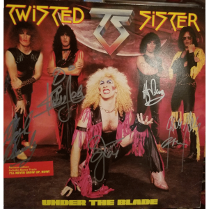 under the blade vinyl signed by all 5 members - A Twisted Christmas